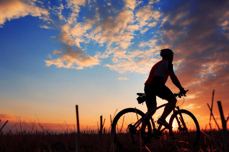 cyclist with sunset in background