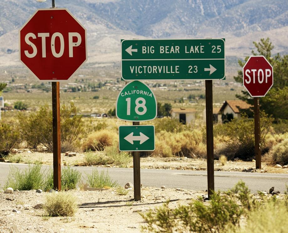 Signs showing distance between Big Bear and Victorville