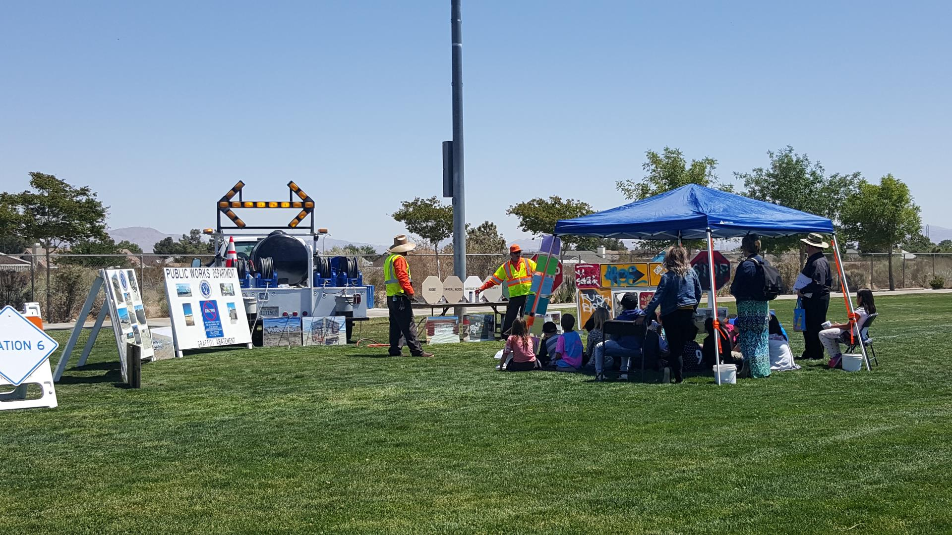 Public Works Day - Students at Traffic Sign Booth