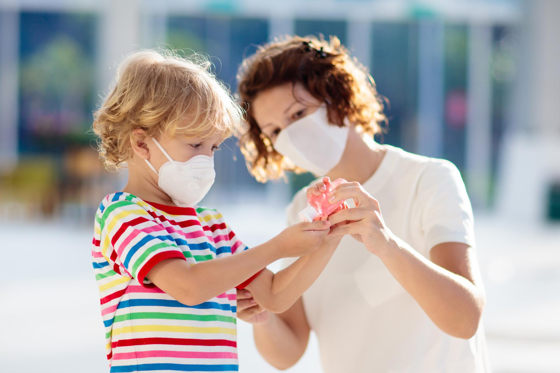 Mother and Child with Masks and Hand Sanitizer